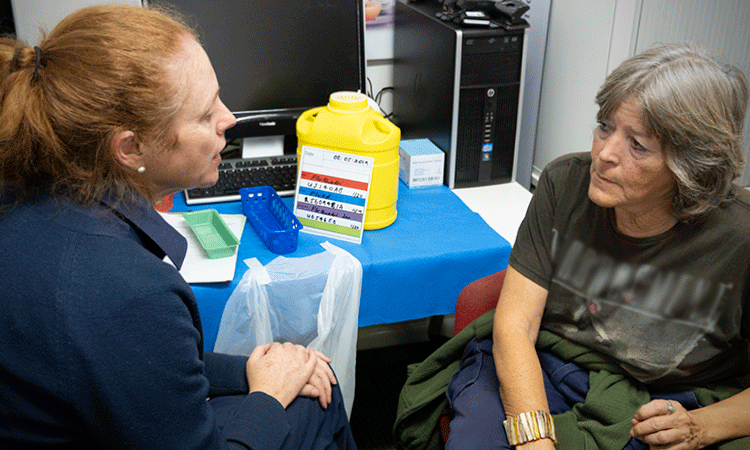 Nurse talking to patient about flu vaccination