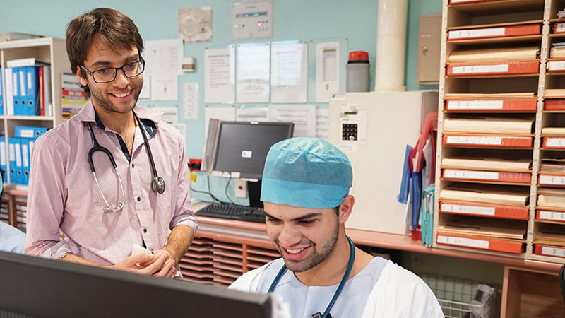 Junior Medical Officers at computer