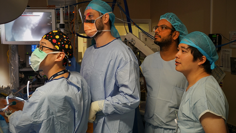 Surgeons looking at monitors in operating theatre