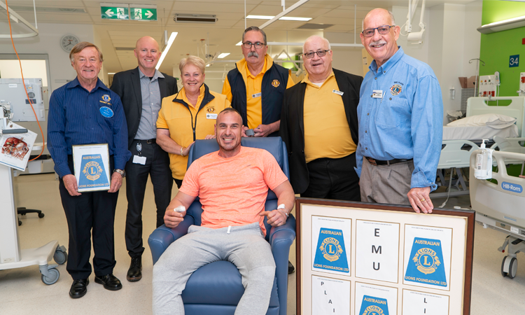Lions Club members with patient